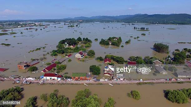 This photo taken on July 7, 2016 shows an overhead view of trees and houses submerged by floodwater in a village in Xuancheng, in east China's Anhui...