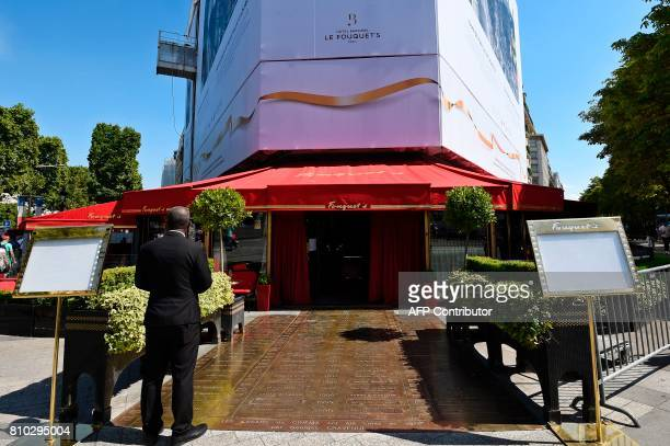 This photo taken on July 7 2017 on the ChampsElysees in Paris shows Le Fouquet's Brasserie while under renovations GUAY
