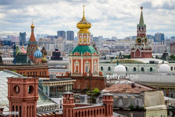 This photo taken on July 8 2018 shows the Kremlin and the St Basil Cathedral in Moscow