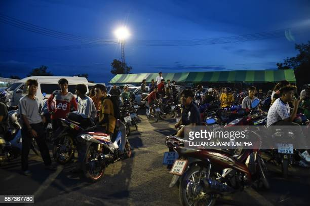 This photo taken on July 9 2017 shows Thai youths hanging out near the racetrack during an 'NGO Street Drag Bike Party' a legal racing event in the...