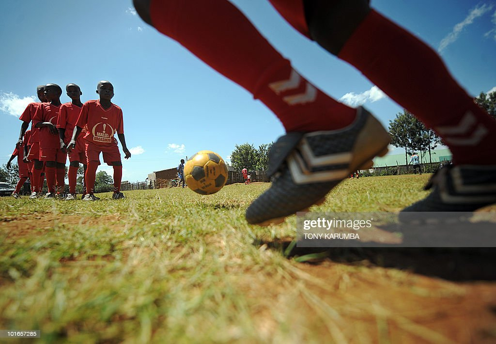 This photo taken on June 01, 2010 shows youngsters during a soccer training session near Kenya's Eldoret town [approximately 300 kilometres north of Nairobi]. One of the hardest hit areas of Kenya by the 2007/08 electoral violence that saw more than 1,500 killed in tribal animosity, soccer in Lugari, an area that borders Eldoret, is being harnessed as a platform to foster unity and reconciliation among local youth drawn from varied tribes of Kenyans that inhabit the area. An intiative by inspired local residents called 'Maliza umasikini, maliza ukabila', [end poverty, end tribalism in swahili] is struggling to draw together the area's youth through soccer matches with barely any funding, using locally made kits and balls to create youth soccer teams, an intiative that residents say has managed to whittle down pulpable tension and animosity among youth from various tribes in the area. AFP PHOTO/Tony KARUMBA