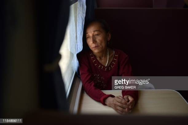 This photo taken on June 1 2019 shows a Uighur woman on a train from Hotan to Kashgar in China's northwest Xinjiang region