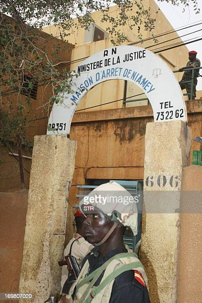 This photo taken on June 1 shows a soldier standing guard at the entrance of the main prison in Niamey Inmates in Niamey's main prison killed two...