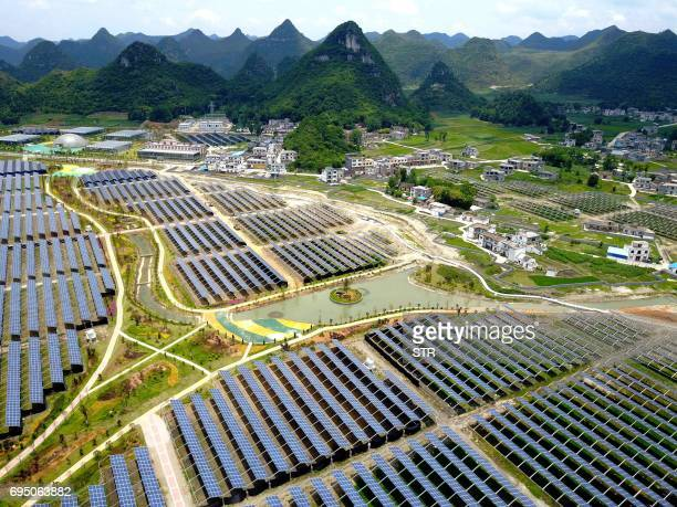 This photo taken on June 10 2017 shows greenhouses built with solar panels on their roofs in Yang Fang village in Anlong in China's southwest Guizhou...