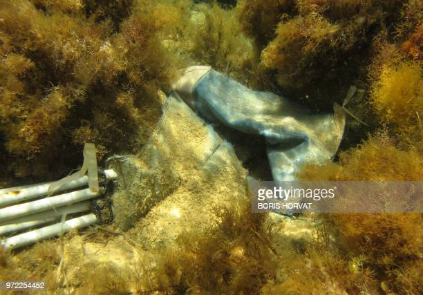 This photo taken on June 10, 2018 shows plastic waste abandonned underwater near the Lindos beach, on the Greek Island of Rhode.