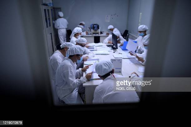 This photo taken on June 10, 2020 shows researchers working in a lab at the Yisheng Biopharma company in Shenyang, in Chinas northeast Liaoning...