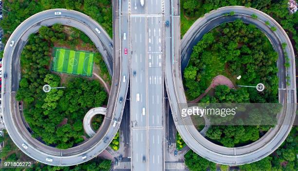 This photo taken on June 11, 2018 shows an aerial view of a football pitch located nearby an interchange in Shenyang in China's northeastern Liaoning...