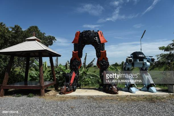 This photo taken on June 13 2017 shows the legs of giant robots at Ban Hun Lek a metalworks shop renowned for giant statues of Transformers the Hulk...