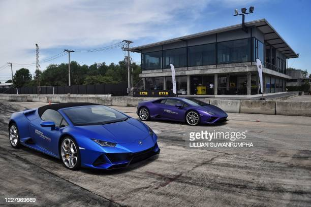 This photo taken on June 13, 2020 shows new models of Lamborghini cars, available for purchase, during a testing session for clients in Bangkok. -...