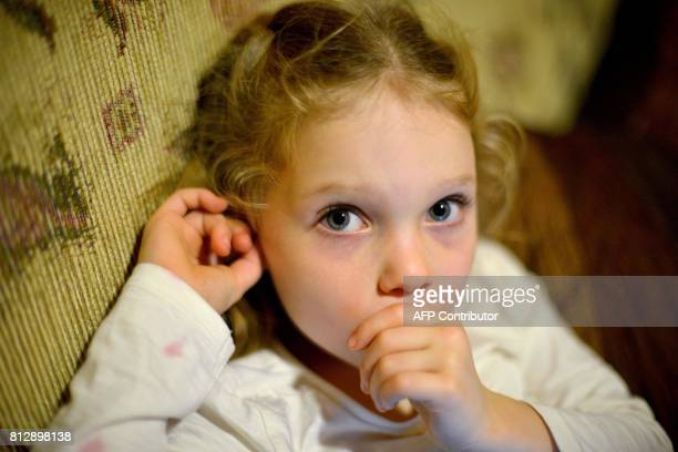 This photo taken on June 16 2017 shows fouryearold Arielle Harding sitting on the sofa at her home in Newcastle 160km north of Sydney Arielle Harding...