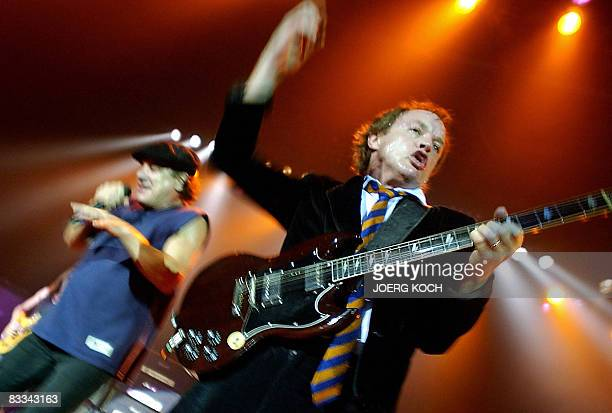 RICARD This photo taken on June 17 2003 shows guitarist Angus Young and lead vocalist Brian Johnson of the legendary heavy metal rock band AC/DC...