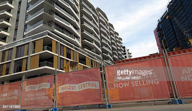 This photo taken on June 17 2016 shows signs advertising new apartments for sale in front of a construction site in Sydney Sydney is imposing new...