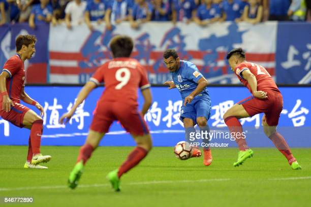 This photo taken on June 17 2017 shows Argentine striker Carlos Tevez of Shanghai Shenhua fighting for the ball in their 13th round match against...