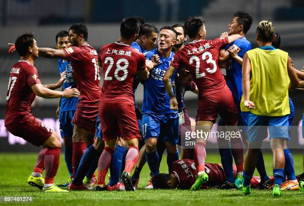 This photo taken on June 18 2017 shows a brawl erupting between Shanghai SIPG players and Guangzhou RF players as Shanghai's Oscar lies on the ground...