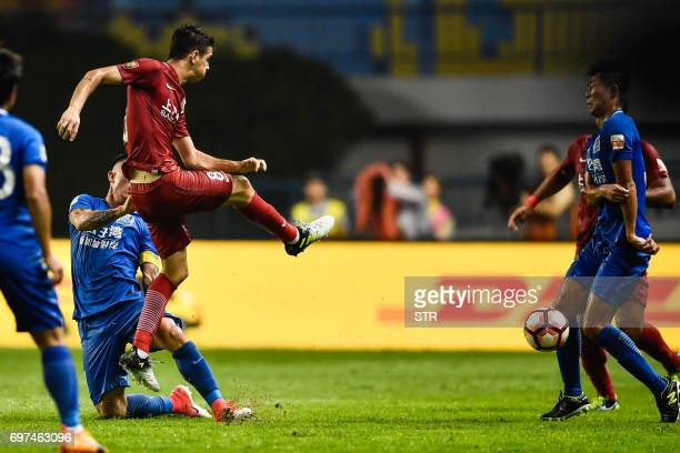 This photo taken on June 18 2017 shows Shanghai SIPG's Oscar kicking the ball at a Guangzhou RF player during their Chinese Super League match in...