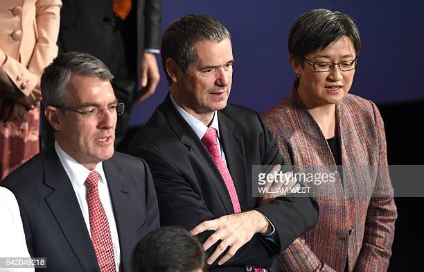 This photo taken on June 19 shows Senator Stephen Conroy shadow minister for defence flanked by Mark Dreyfus the shadow attorney general and Senator...