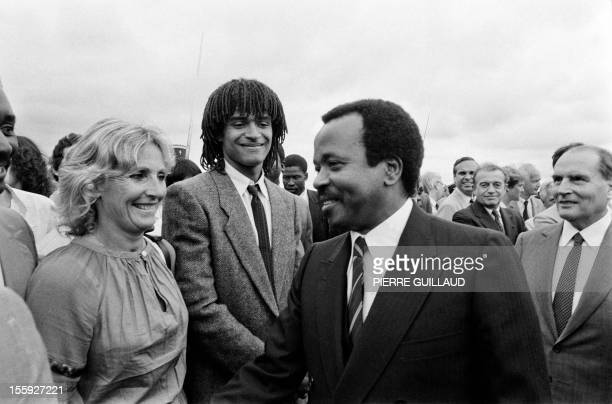 This photo taken on June 20, 1983 shows President of Cameroon Paul Biya welcoming his French counterpart François Mitterrand , French tennisman...