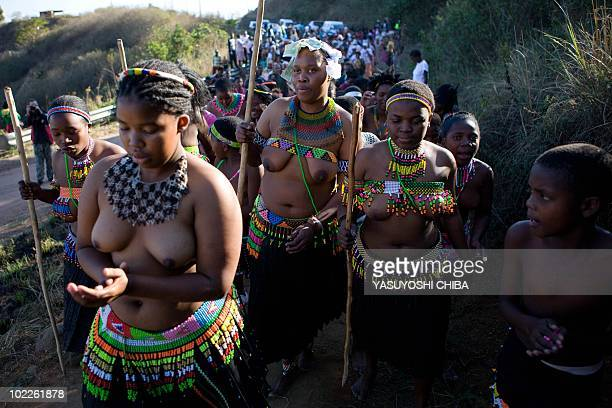 This photo taken on June 20 2010 shows unmarried Zulu girls marching during an engagement ceremony in the village of Inanda north of Durban in...