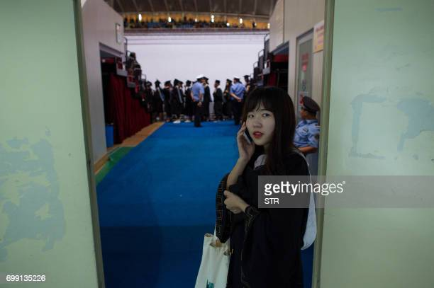 This photo taken on June 20 2017 shows a graduate making a phone call during the Huazhong University of Science and Technology graduation ceremony in...