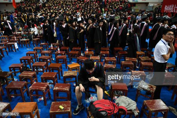 This photo taken on June 20 2017 shows students from the Huazhong University of Science and Technology taking part in their graduation ceremony in a...