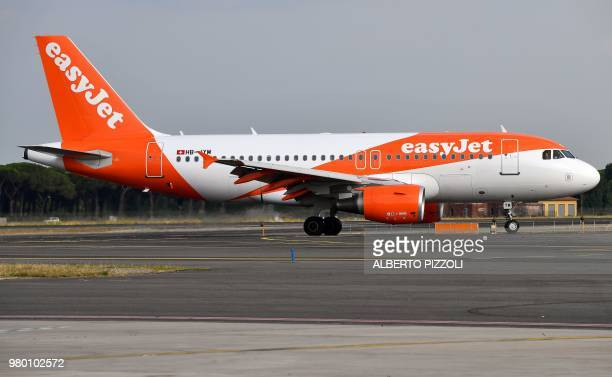 This photo taken on June 21 2018 shows an EasyJet plane rolling on the tarmac at the Fiumicino Airport in Rome