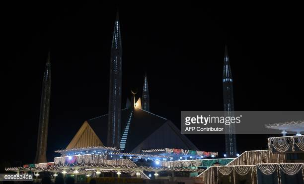 This photo taken on June 22 2017 in Islamabad shows an illuminated Faisal Mosque on Lailat alQader also known as the Night of Power and the 27th...