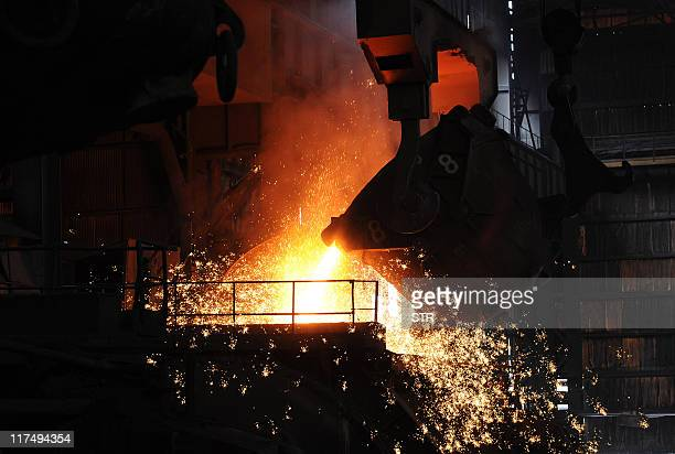 This photo taken on June 25 2011 shows a giant cauldron at a steel mill in Hefei in eastern China's Anhui province Growth in China's manufacturing...