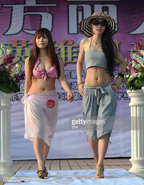 This photo taken on June 25 2011 shows a group of Chinese women parading in their swimwear during a matchmaking event for wealthy men with assets...