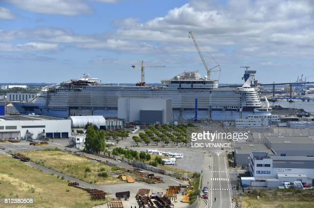 This photo taken on June 25 2017 in SaintNazaire shows the dockyard for the construction of the Oasis 4 slated to become the biggest cruise ship in...