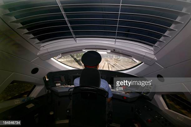 This photo taken on June 27 2011 shows a train driver operating a highspeed train heading to Shanghai during a trial run from Beijing A top railway...