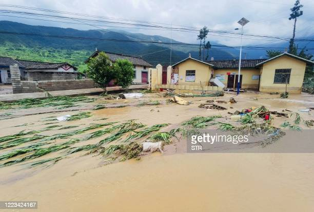 This photo taken on June 27, 2020 shows submerged streets and inundated buildings after heavy rain caused flooding in Mianning county, in the...
