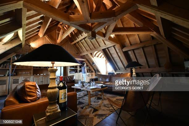 This photo taken on June 28 2018 shows the smoking room of the Chateau Angelus in Saint Emilion near Bordeaux The Chateau Angelus is a wine estate in...