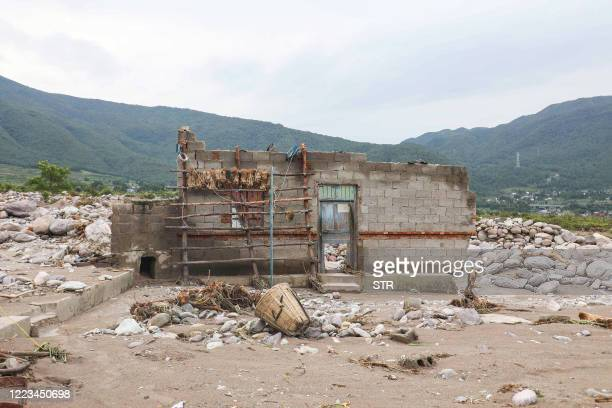 This photo taken on June 28, 2020 shows a house in the aftermath of flooding caused by heavy rainfall in Mianning county, in the Liangshan Yi...
