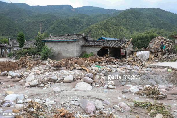 This photo taken on June 28, 2020 shows the aftermath of flooding caused by heavy rainfall in Mianning county, in the Liangshan Yi Autonomous...