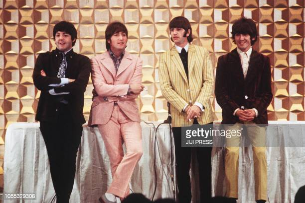 This photo taken on June 29 1966 shows members of the British band The Beatles Paul McCartney John Lennon Ringo Starr and George Harrison holding a...