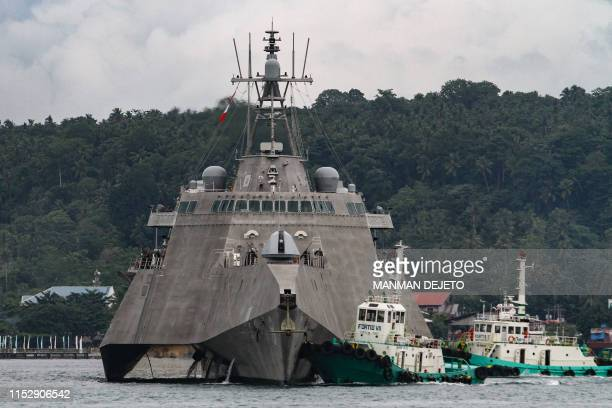 This photo taken on June 29 shows USS Montgomery an Independenceclass littoral combat ship of the United States Navy in Davao City on the southern...
