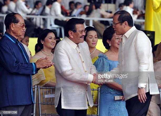 This photo taken on June 30 2010 shows former Philippine president Joseph Estrada shaking hands with President Benigno Aquino prior to the latter's...
