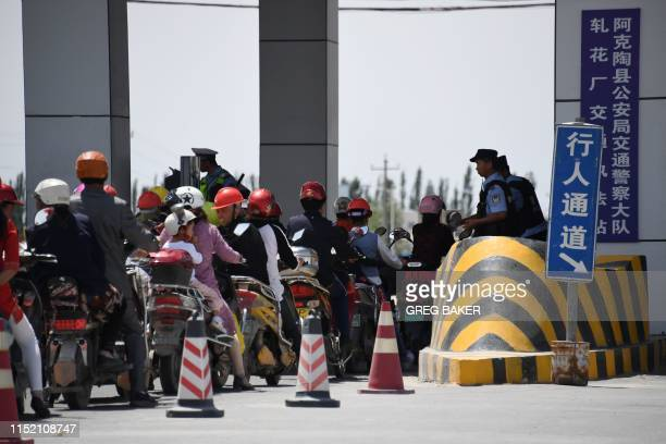 This photo taken on June 4 2019 shows a police checkpoint on a road near a facility believed to be a reeducation camp where mostly Muslim ethnic...