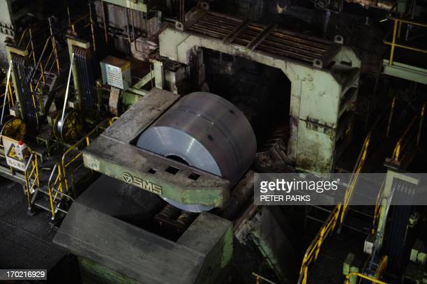 This photo taken on June 6 2013 shows rolls of steel at the end of the hot rolling plant at the Baosteel steel mill in Shanghai during a tour of the...