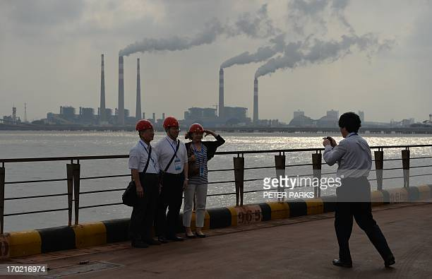 This photo taken on June 6 2013 shows visitors taking photos at the Baosteel steel mill in Shanghai during a tour of the plant China's industrial...
