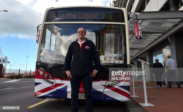 This photo taken on June 6 2017 shows Joel Watson first secretary at the British High Commission posing in front of of a bus in Auckland set up as a...