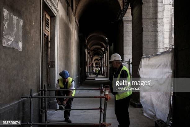 This photo taken on June 7, 2016 shows employees of Eiffage Construction group working at the Hotel Dieu in Lyon. The renovation of the Hotel Dieu,...