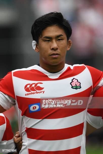 This photo taken on June 9 2018 shows Japan's flanker Yoshitaka Tokunaga posing during the anthems prior to the rugby union Test match between Japan...
