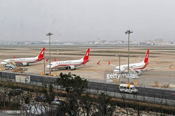 This photo taken on March 11 2019 shows three Boeing 737 MAX 8 planes from Shanghai Airlines parked at Shanghai Hongqiao International Airport in...