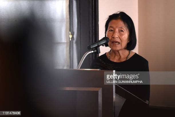 This photo taken on March 12 2019 shows Pranee Danwattananusorn speaking to an audience about her missing husband Thai activist Surachai...