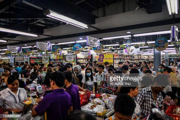 This photo taken on March 12 2020 shows people panic buying groceries in a supermarket after hearing rumours related to the COVID19 coronavirus in...