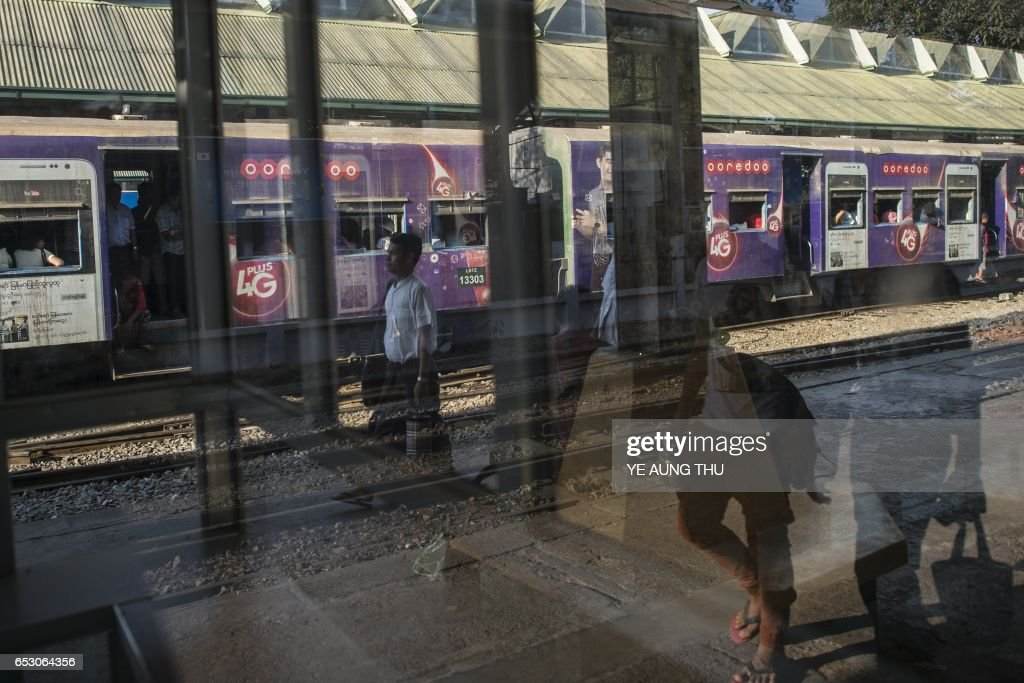 This photo taken on March 13, 2017 shows a man walking in the Yangon Railway station in downtown Yangon. / AFP PHOTO / Ye Aung THU