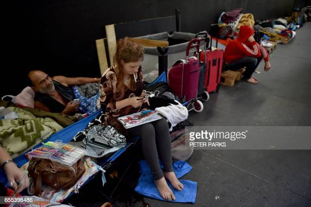 This photo taken on March 13 2017 shows homeless man Lanz Priestley and 20yearold Nina Wilson in a makeshift shelter for the homeless in Sydney which...