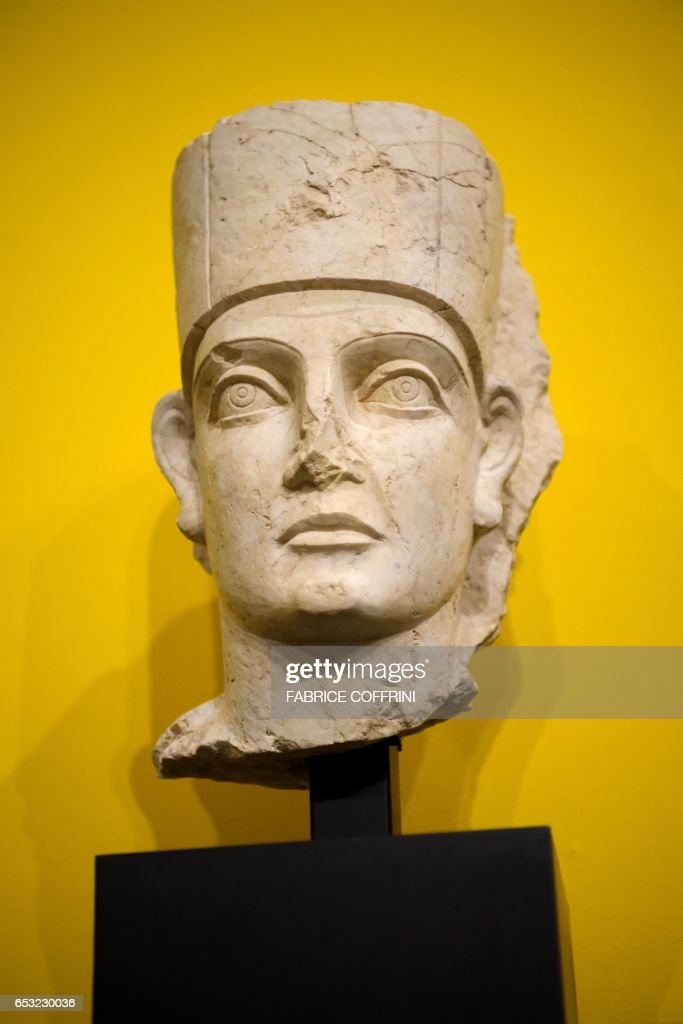This photo taken on March 14, 2017 at Geneva's Museum of Art and History shows a statue of the head of a priest wearing a modius headdress from Palmyra, Syria, discovered during a custom control on April 2013 in the Geneva Freeport warehouse complex, during an exhibition on the illegal trafficking of archaeological objects before being returned. Geneva's Museum of Art and History displays for several months nine cultural relics looted from Syria's ancient city of Palmyra, as well as from Libya and Yemen, which were being stored in Geneva's Freeport warehouse complex and seized by the Canton of Geneva. The objects will be on display from March 14 until September 30 of 2017. PHOTO / Fabrice COFFRINI / RESTRICTED