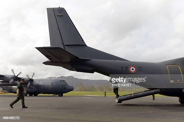 This photo taken on March 16 2015 shows a C130 Hercules from 40 Squadron of the Royal New Zealand Air Force from Auckland and a French Army Casa...